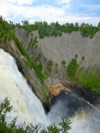 rushing water: Log jam at bottom of a waterfall