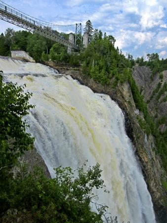 Beautiful view of suspension bridge over dramatic waterfalls