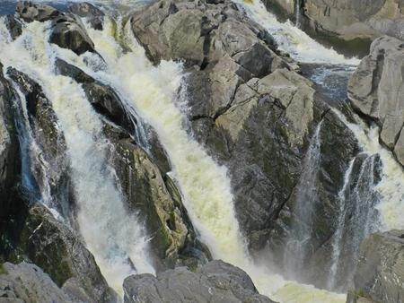 rushing water: Closeup of water rushing over rocks