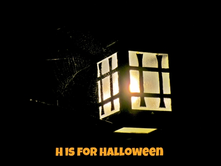Lantern with spider web and Halloween text Stock Photo