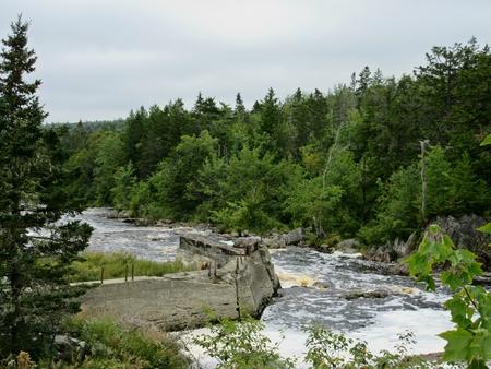 infrastructures: Old remnants of bridge infrastructure on a Nova Scotia river.