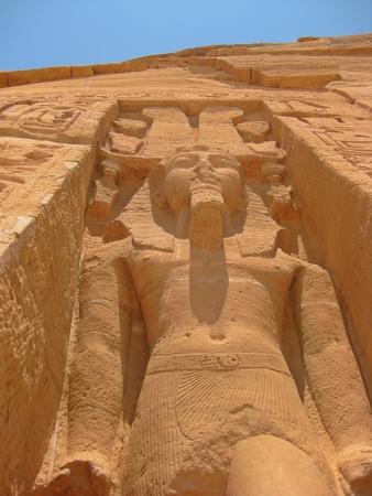 abu simbel: Looking up at a sharp angle at a Pharaohs statue at Abu Simbel