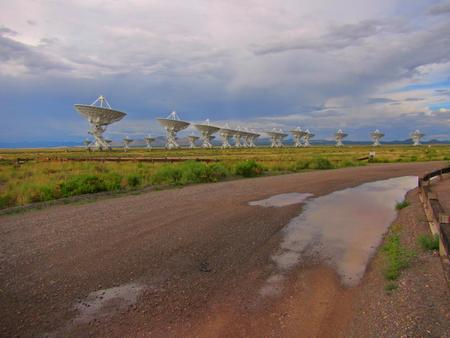 very: The road along the Very Large Array of radio telescopes in New Mexico. Stock Photo