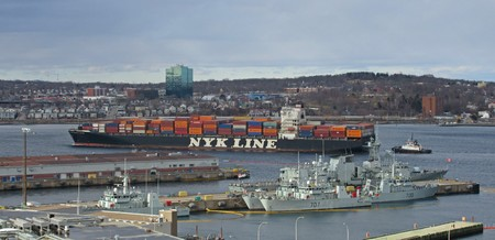 newsworthy: Large container ship navigating Halifax Harbour past the Naval Base.