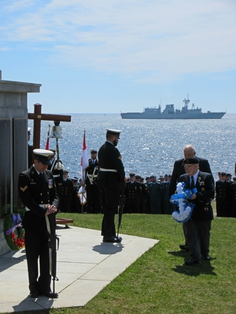 Laying of a wreath at the 2016 Battle of the Atlantic memorial service in Halifax Nova Scotia with the HMCS Montreal on the horizon.