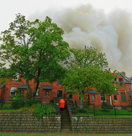 evacuating: Emergency responder evacuating buildings near fire in Halifax Nova Scotia, Canada Editorial