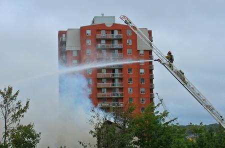 scotia: Firefighters fighting a city fire in Halifax, Nova Scotia, Canada