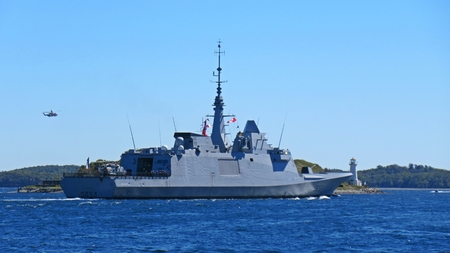 windsor: Antisubmarine ship and military helicopter near McNabs island in Halifax harbor during NATO exercises Editorial