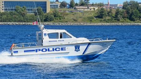 Halifax Regional Police boat patrolling Halifax Nova Scotia harbor,