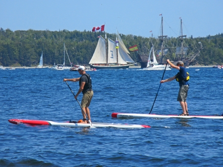 Paddleboarders during tall ships event in Halifax Nova Scotia Editorial