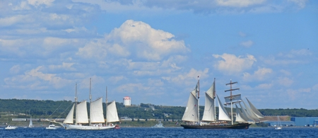 Tall ships coming and going in Halifax Nova Scotia during Tall Ships Rendezvous 2017 Editorial