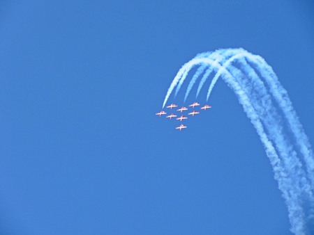Famous RCAF Snowbirds flying demonstration team beginning a loop maneuver.