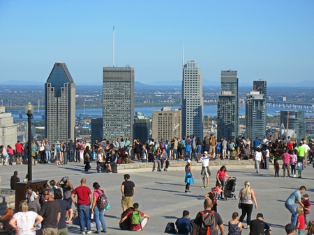 City of Montreal from Mont Royal observation overlook with tourists. Banco de Imagens - 85672060