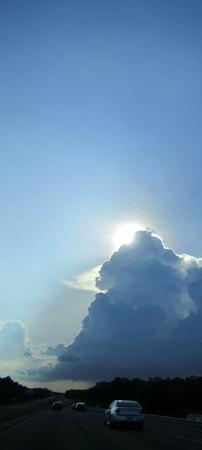 Dramatic cloud amd sun. Banco de Imagens