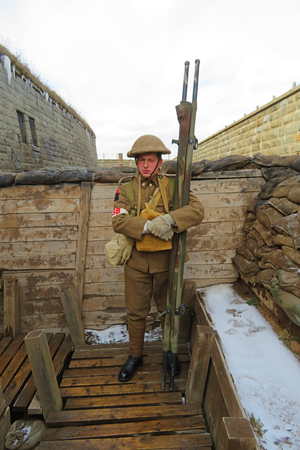 Simulation of First World War Canadian stretcher barer in the trenches of France, Photograph taken in Halifax, Nova Scotia, Canada at Citadel Fort on Citadel Hill. Editorial