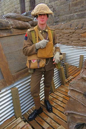Actor portraying First World War Canadian soldier in the trenches of France at Historic Halifax Citadel Fort in Nova Scotia, Canada.