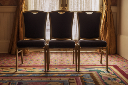 banquet facilities: Chairs In A Hotel Corporate Meeting Room Stock Photo
