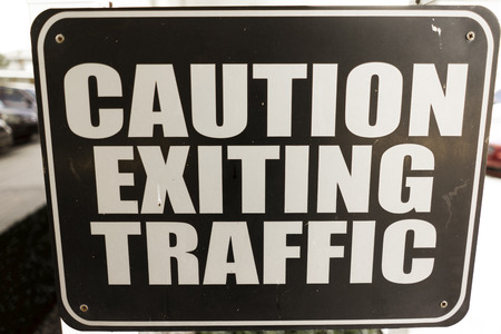 security symbol: Caution Exiting Traffic Sign Words Warning