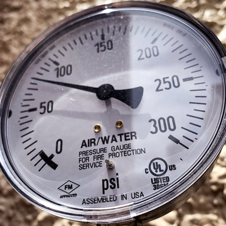 Pressure Guage On The Street For Water And Air Stock Photo