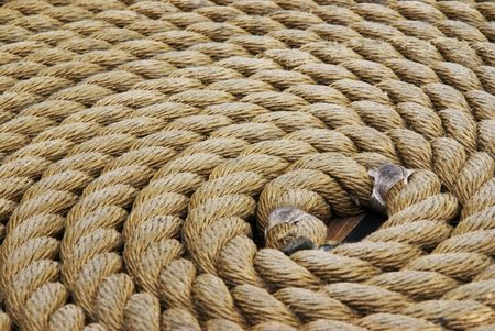 Thick rope coiled flat on the floor            photo
