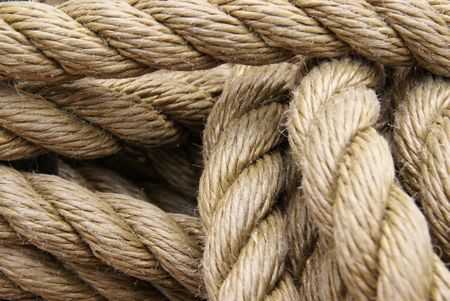 Medium closeup of tied thick rope            photo