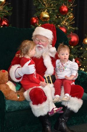 Kinderen op schoot van de kerstman