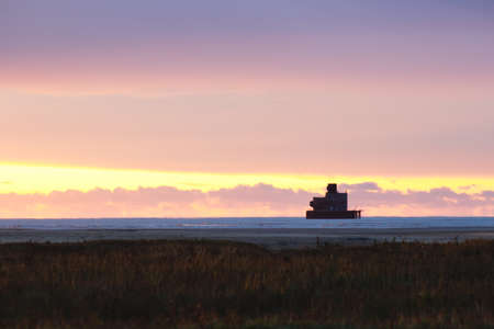 One of the Humber Estuary Forts viewed from the Meridian Point in Cleethorpes at sunrise