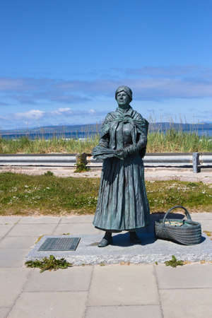 Nairn, Highlands, Scotland, UK - June 01, 2016: Statue depicting a fishwife located near the harbour.