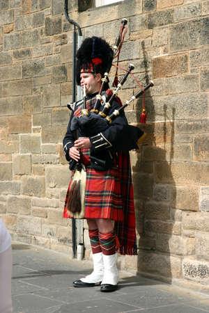 Edinburgh, Scotland, UK - September 18, 2011: Scottish Piper playing the bagpipes in Edinburgh. Editorial