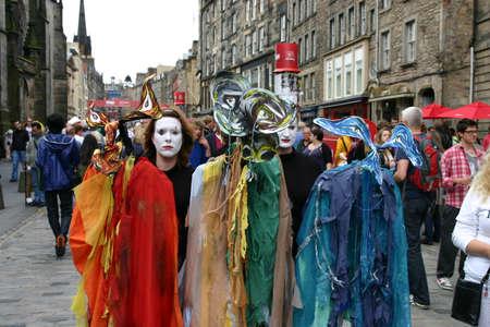 Edinburgh, Scotland, UK - August 19, 2011: Colourful Street Entertainers at the Edinburgh Festival in Scotland