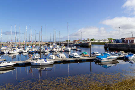 Nairn, Highlands, Scotland, UK - June 01, 2016: View of Nairn harbour in the Highlands of Scotland showing moored boats and yachts.