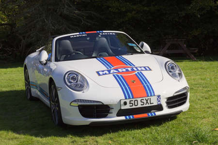 East Kilbride, South Lanarkshire, Scotland, UK - August 31, 2014: Porsche Boxster convertible with Martini decals.