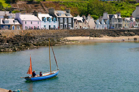 Portpatrick, Dumfries and Galloway, Scotland, UK - May 27, 2012: Boat Leaving Portpatrick in Scotland on a sunny day.