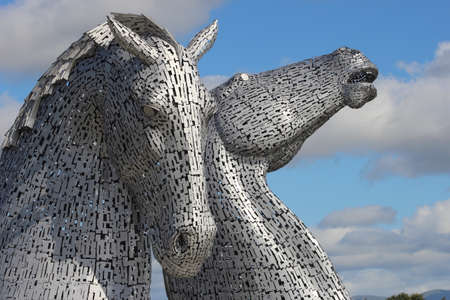 Falkirk, Stirlingshire, Scotland, UK - July 17, 2014: The Kelpies in the Helix Park on the Forth & Clyde canal entrance on the East coast of Scotland.