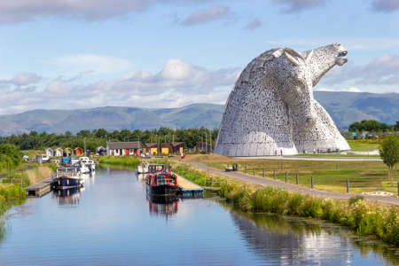 Falkirk, Stirlingshire, Scotland, UK - July 17, 2014: A view of the Falkirk Kelpies at the Forth & Clyde canal entrance on the East coast of Scotland.