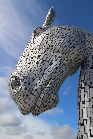 Falkirk, Stirlingshire, Scotland, UK - July 17, 2014: One of the Kelpies in Falkirk at the Forth & Clyde canal entrance on the East coast of Scotland. Editorial