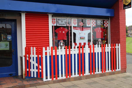 New Cumnock, East Ayrshire, Scotland, UK - May 30, 2014: Shop decorated in support of New Cumnock's Glenafton football team in advance of the Scottish junior cup final.