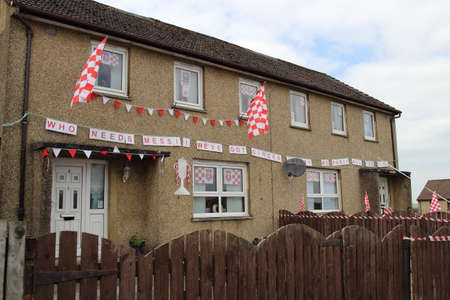 New Cumnock, East Ayrshire, Scotland, UK - May 30, 2014: Houses decorated in support of New Cumnock's Glenafton football team in advance of the Scottish junior cup final.