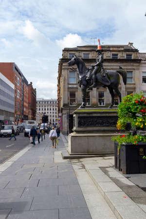 Glasgow, Scotland, UK - June 27, 2015: The Duke of Wellington Equestrian statue outside the museum of modern art in Glasgow. Editorial