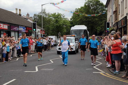 East Kilbride, South Lanarkshire, Scotland, UK - June 22, 2014: The Queen's Baton Relay for the Glasgow Commonwealth Games 2014 arrives in the East Kilbride village, South Lanarkshire.