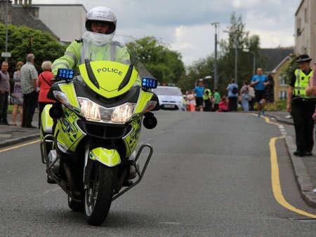 East Kilbride, South Lanarkshire, Scotland, UK - June 22, 2014: Police Scotland Motorcycle Police Officer.