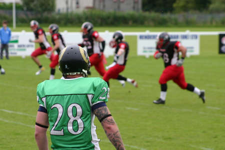 Hamilton, South Lanarkshire, Scotland, UK - August 28, 2011: East Kilbride Pirates American football player watching play taking place. Editorial