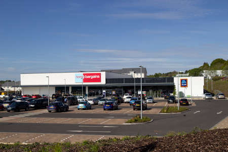 East Kilbride, South Lanarkshire, Scotland, UK - May 13, 2019: The new Home Bargains and Aldi stores that have been built on the old Rolls-Royce site in East Kilbride, South Lanarkshire, Scotland, UK.