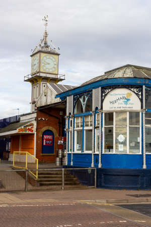 Cleethorpes, North East Lincolnshire, England, UK - August 18, 2020: The clock tower at Cleethorpes railway station and the mermaid cafe.