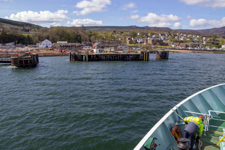 Approaching the ferry terminal in Brodick on the Isle of Arran, in the Firth of Clyde, Scotland. Stock Photo
