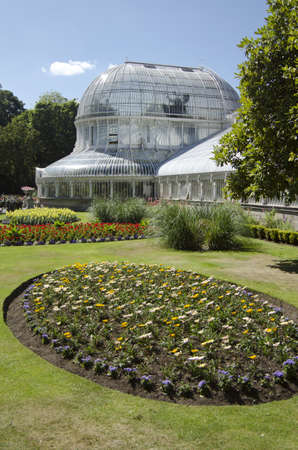 northern ireland: Popular Irish tourist site, The Palm House is one of the earliest curvilinear cast iron glass houses. Situated in Belfasts Botanic Gardens the Victorian structure was completed in 1840.