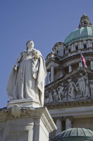 northern ireland: Statue of Queen Victoria situated in the grounds of Belfast City Hall, Northern Ireland, UK. Stock Photo