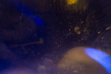 View through blue stardust,in motion,approaching yellow planet Stock Photo