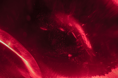 View through red stardust,while approaching a planet