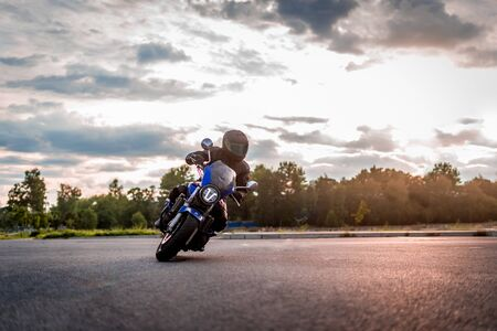 biker rides on the road on a motorcycle Stock fotó